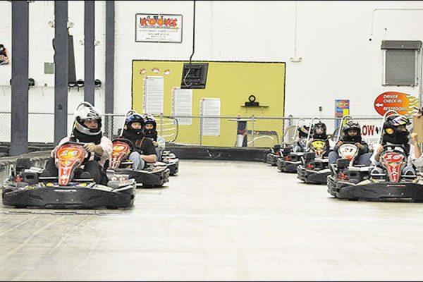 Go karts on track at The PIT Indoor Kart Track