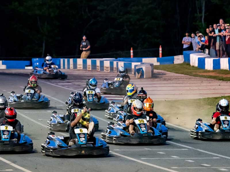 Racers on the track at GoPro Motorplex in Mooresville NC during the Little 600