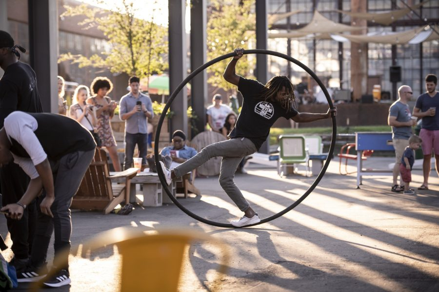 Street performer in a ring at Camp North End Charlotte NC